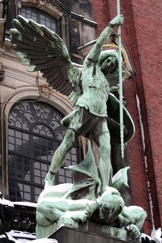 statue of the Archangel Michael in front of St. Michael's Church, Hamburg (Hauptkirche Sankt Michaelis, colloquially called Michel)