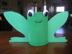 I like that this can stand up.  -  i would re-do the eyes to incorporate the top of the frogs head. ~ and maybe add some front legs.  would be cute pinned to a tree on the preschool wall.