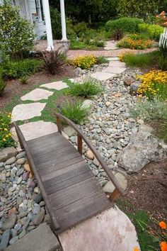 Beautiful, water-saving dry creek bed in the front yard. I want a bridge designed somehow/somewhere in my flower bed by aftr