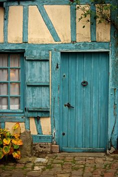"The blue house in Gerberoy, Picardie, France housed wig artisans who provided ""powdered wigs"" worn by the canons in the 18th century."