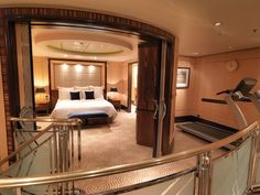 CUNARD: QUEEN MARY 2.  Each of the Grand Duplexes' master bedrooms are reached via dramatic, curving staircases.