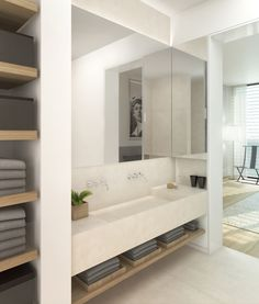 contemporary white solid surface wall hung basin with oak storage shelving