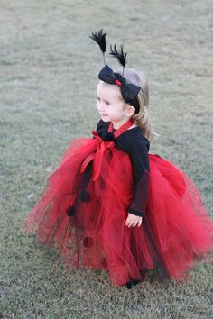 I'm thinking Alyssa might be a ladybug for halloween.  I like the black tulle and pompoms on the long tutu.