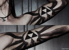 Triforce tattoo. By far, one of the coolest nerd tattoos ever.