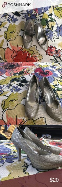 Aldo heels Silver sparkly heels I wore them with my prom dress and never worn again the sat in my closet for a while and the is so glue on the front seem but that could easily be taken care of Aldo Shoes Heels