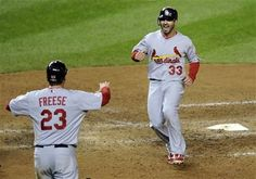 Game 5 of the NLDS- Descalso and Freese celebrate after scoring 10-12-12