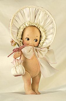 "R John Wright Dolls - PInk Bonnet Kewpie® 6"", all felt, fully jointed, hand painted features. Wearing removeable felt, and silk bonnet. Holding a felt and silk purse. Date of Release: 2002 Ltd. Ed. 250. Part of the KEWPIE® EASTER COLLECTION."