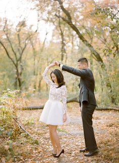Dancing among the leaves: http://www.stylemepretty.com/little-black-book-blog/2014/12/18/elegant-autumn-new-york-city-engagement-session/   Photography: Rebecca Yale - http://rebeccayaleportraits.com/