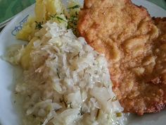 Kotlet schabowy – A pork cutlet with potatoes and cabbage with dill. @Hecktic Travels