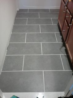 """Mitte Gray 12"""" x 24"""" tile from Lowes, $1.99 a square foot."""