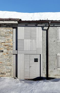 """Wardrobe in the landscape, a micro weekend retreat consisting of a small wooden """"box"""" building fitting between 2 existing buildings by Enrico Scaramellini Architetto."""