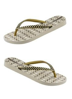 Comfortable beige tribal print flip flops with black and metallic gold zig zag detail on straps.  Flip flop is constructed of 100% recyclable material by Ipanema Flip Flops, $20.00