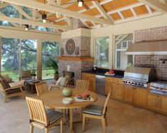 Screen porch with outdoor kitchen and fireplace... great additional dining space for vacation or lake home