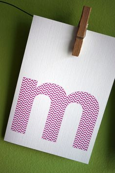 simple letters on white rectangles hung with clothespins