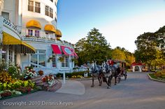 The Grand Hotel, Mackinac Island, MI. No motorized vehicles at all. Just rolleblades, bikes or horses for an 8 mile track around the island. Beds and breakfast, horse-drawn carriages, and lots of good food. Camping across the bay by ferry at St. Ignace.