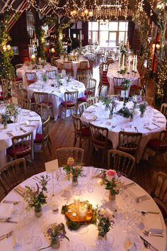 A Midsummer Nights Dream themed wedding at Ramster Hall with artificial foliage to dress the upright beams, twisted willow trees, pealights, slice centrepieces and uplighters by www.stressfreehire.com #venuetransformers