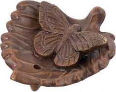 Ceramic Butterfly on Leaf  This ceramic incense burner exhibits a beautiful butterfly that is sitting on a leaf. The Butterfly signifies metamorphosis, immortality, elegance, and self-transformation.  $ 8.45 http://incensediscount.com/product/clay-incense-holder-ganesh-on-lotus/
