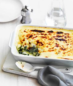 Wilted greens and potato with cheese sauce