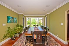 Separate dining room with a long and narrow shape and a matching table