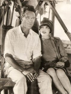 "Clara Bow with director Victor Fleming, 1926. Typed on reverse: "" WATCH YOUR CREDIT INTERNATIONAL NEWSREEL photo 886 LOS ANGELES BUREAU (SLUG) CLARA BOW & VICTOR FLEMING LOS ANGELES — Clara Bow, screen star, is shown here with Victor Fleming, movie..."