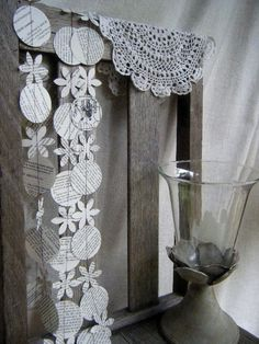 Ornament and snowflake garland from old magazines and books