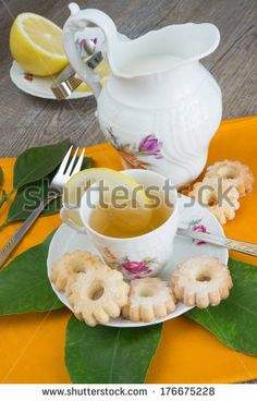 composition of breakfast with lemon tea, milk and cookies. by enzodebernardo, via Shutterstock