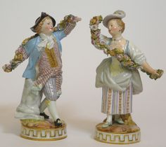 "pair Porzellanfiguren Meissen 1) lad with garland of flowers, model from Michel Victor Acier. At grassroots level blue Knaufschwertermarke 1850-1924, scarified model number ""F. 67"", Pressziffer ""122"" and in gold on-glaze ""31"". On round base dance-like bewegter, courtly dressed boy with flower garland, colored and gold fitted out. Old renovation at the hem of a / the skirt, minimal chip the three-dimensional blossoms. Height: approximate 16, 5 cm. 2) girl with garland of flowers, model from…"