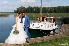 A beautiful ceremony in the rain at a summer cottage, couple portraits on a boat and then the sun came out to celebrate at Adventure Valley at this Porvoo Wedding.