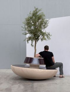 Chitchat by Teun Fleskens: A social networking public bench as sitting by more than one occupant inevitably rocks the entire unit!