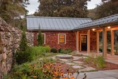 love the breezeway attached to the storage space. The standing seam roof, and the low maintenance garden!