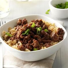 Korean Beef and Rice Recipe -A friend raved about Korean bulgogi—beef cooked in soy sauce and ginger—so I tried it. It's delicious! Dazzle the table with this tasty version of beef and rice. —Betsy King, Duluth, Minnesota