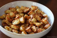 These delicious roasted potatoes are simple to make, with cubed potatoes, Parmesan cheese, olive oil, and some seasonings.