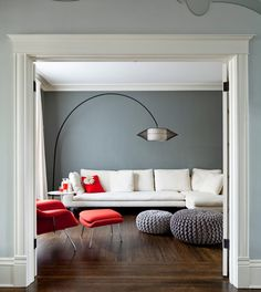 dark floors, gray walls, red chair - for an idea how the orange couch would look