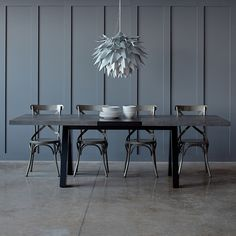Inspired by traditional trestle tables, the Apex dining table is constructed with a concrete and black finish. Fits perfectly into industrial interiors, but also works as a stark contrast in contemporary styled rooms too. Additionally, it can be extended with the addition of a smart black panel.