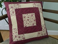 "Burgundy or maroon and beige patchwork quilted pillow cover fits a standard 16"" pillow insert (not included). 16"" x 16"" The quilted pillow cover front is made with three coordinating cotton fabrics - burgundy with tiny burgundy print; beige and burgundy floral print; beige and white floral print. The pillow cover is backed with the darker burgundy floral fabric. #quiltedpillow #decorativepillow #maroonpillow"