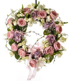 "Soft and sweet best describes the subtle color combination in this wreath. Soft pink, lavender and white are timeless spring colors. Mix of cabbage roses, hydrangea and tulips create this beautiful wreath. Perfect for indoor or outdoor. Features Available in 2 sizes All wreaths are made to order in Powell, Ohio Designer Quality Imported Silk Floral Perfect for indoor or outdoor use Coordinating Arrangements & Centerpieces available 26"" Wreath recommended for front door"