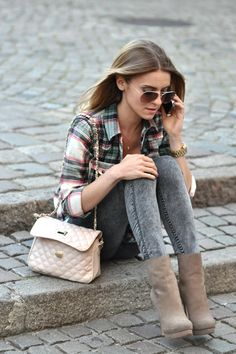 Feminine purse and heeled booties make the flannel cute and fashionable