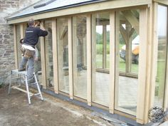 Fitting Glass to Oak Framed Conservatory Extension in Cornwall by Carpenter Oak Ltd Glazing Department