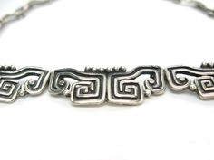 Margot De Taxco Necklace. Sterling Silver Jewelry. Taxco Silver. Choker Necklace. Pre-Columbian Design. Vintage 1950s Mexico Jewelry. by bohemiantrading on Etsy https://www.etsy.com/listing/241065944/margot-de-taxco-necklace-sterling-silver