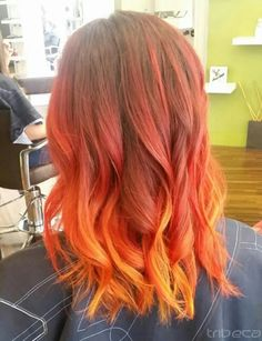 It's Hot Out and so is this Fire! Hair by Mickie. This fashion color melt created with balayage highlighting and strategic color placement