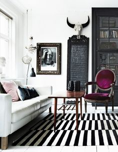 Images from domainehome.com  You know how much I love black & white decor and spaces. So, when I came  across this incredible design in a Danish house I knew I had to save it in  my official inspiration folder; AND share it with you :)  The mix of modern and classic pieces and the strong presence of black  makeit so glamorous and clean at the same time. I adore the painted white  floors which createawhite canvas box for the design.I LOVE the space.  And the pops of color, which are...