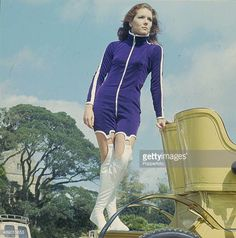 English actress Diana Rigg posed on a vintage car on location during filming of the television series 'The Avengers' at Beaulieu Hampshire in 1966