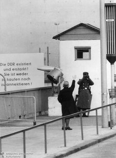 Visitor from West Berlin (1966)-Immediately after the construction of the Berlin Wall, West Berliners were entirely prohibited from visiting relatives in the Eastern section of the city. As the decade wore on, various permit agreements gradually allowed for some family visits. It was only at the beginning of the 1970s, however, that West Berliners were able to visit their East Berlin relatives on a regular basis. In this 1966 photo, a West Berliner bids farewell to relatives on the Eastern…