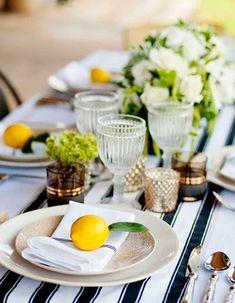 Une décoration de table d'été acidulée via des agrumes déposés sur la table
