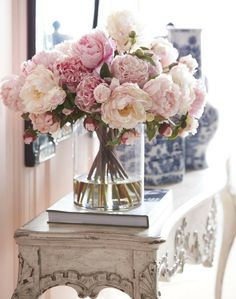 A beautiful floral arrangement of peonies. A beautiful floral arrangement of peonies.