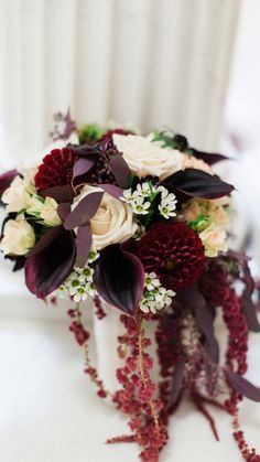 Burgundy calla lilies ivory roses