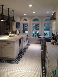 New Vintage Kitchen at ModVintageLife.com I'm so very in LOVE with this kitchen!!! Those lights! The marble counter tops! The mosaic floor! The bank of windows! The farmhouse sink! Those lights AGAIN!!! on and on...