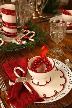 The Christmas Table in red and white. These plates and footed bowls are adorable and really different. Just found out these were from Crate & Barrel back in 2009, so I guess I'll scratch them from my wish list....