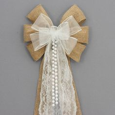 This white sheer burlap wedding bow is accents with lace and pearls. This burlap pew bow is a perfect decoration for a rustic wedding theme. Bow Details: - 6 loops of 2 burlap with wire edge. Burlap Pew Bows, Burlap Lace, Hessian, Wedding Pews, Rustic Wedding, Wedding White, Wedding Church, Camo Wedding, Wedding Dresses