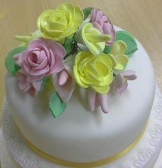 Gumpaste flower bouquet tier tower cake by Htea1